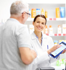 pharmacist talking to her customer