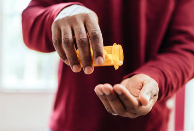 man taking his medication