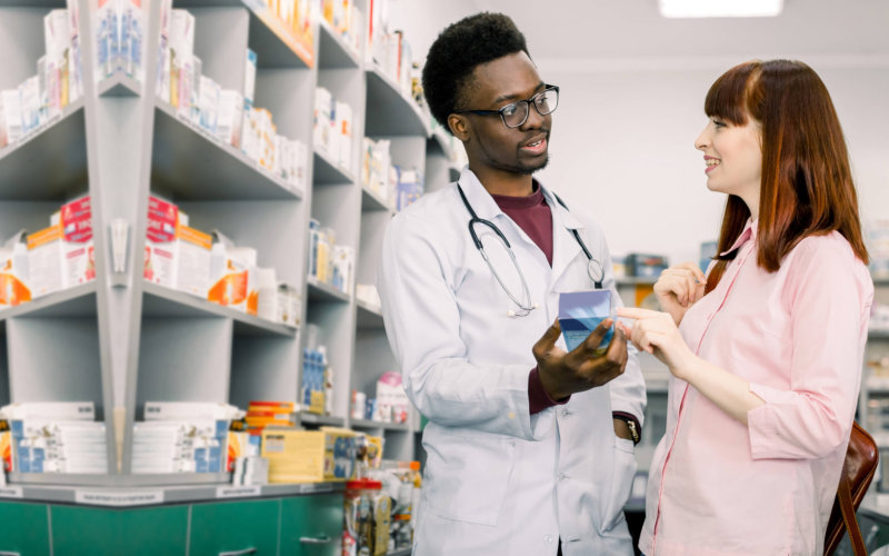 pharmacist recommending a medicine to his customer